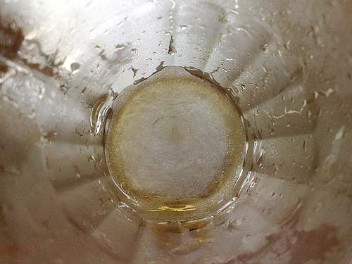 Frozen root beer at the bottom of glass